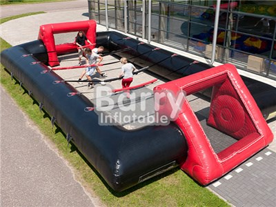 Cheap price customized human table football, inflatable foosball court BY-IS-037